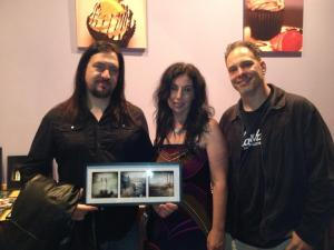 My friend Justin holding up his piece he bought that he said reminded him of his mom...On my right is Paul, a talented photographer!